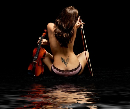 young girl playing violin over black photo
