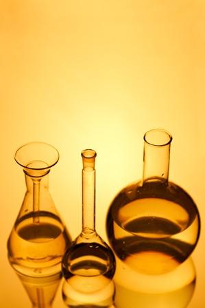 laboratory flasks on turn blue background photo