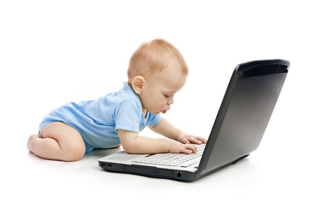 Infant using laptop over white photo
