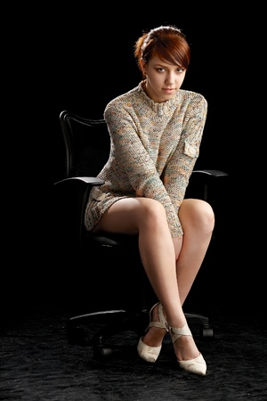 beauty woman sitting over chair Stock Photo - 8825678