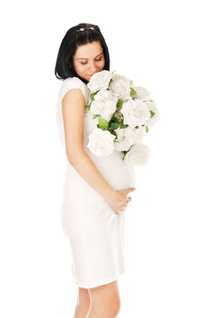 pregnant with roses on white photo