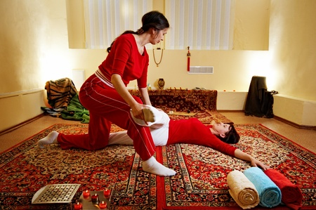Thai massage is a type of massage in Thai style that involves stretching and deep massage. photo