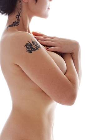 denuded brunette with tattoo isolated on white background