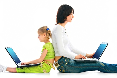 woman and child with laptop on white background Stock Photo