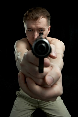 man with weapon isolated on black background photo