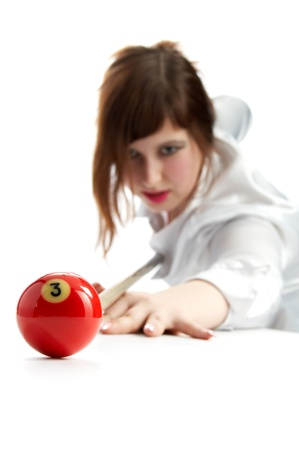woman with cue and billiard ball isolated on white background Stock Photo