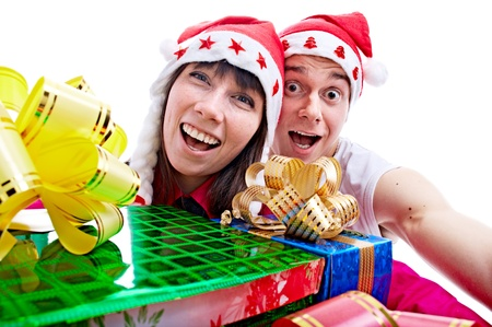 portrait of the lucky people with gift for Christmas isolated on white background Stock Photo - 8845744