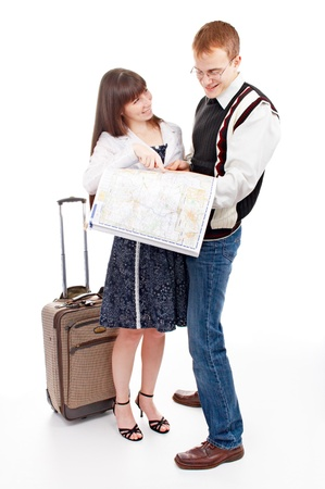 two young people with valise and with map on white background photo