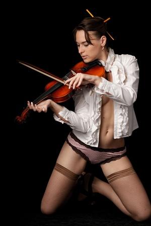 violinist isolated on black background Stock Photo - 8846918