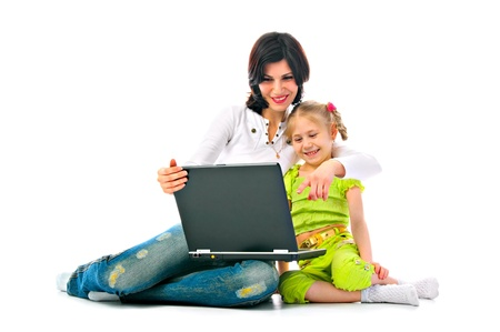 mum and daughter with laptop on white background Stock Photo
