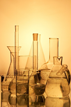 laboratory container on yellow background photo