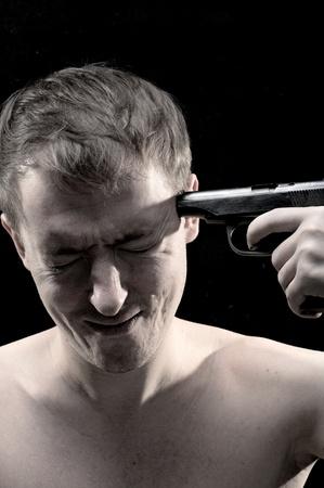 portrait men with gun on black background photo