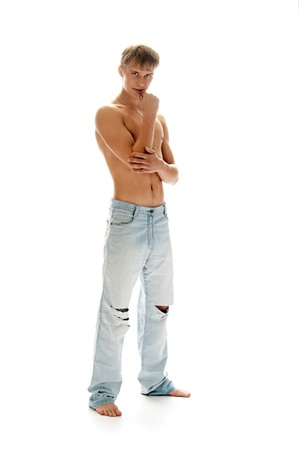 sexual man in jeans solated on white background photo