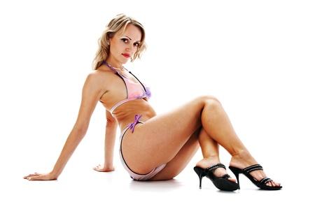 striptease women: sexual brunette in bikini on white background