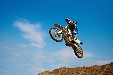 man on motorcycle on background blue sky Banco de Imagens
