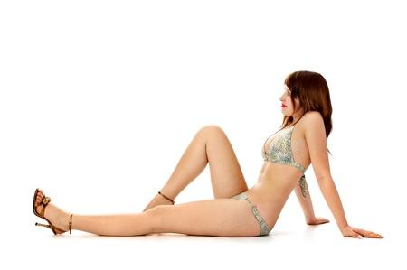 seductive brunette in bikini isolated on white background photo
