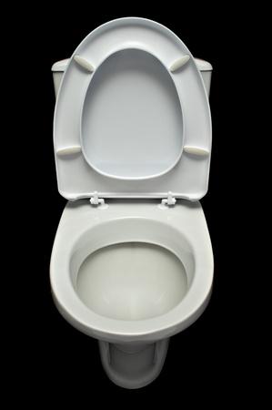 white lavatory pan isolated on black background photo