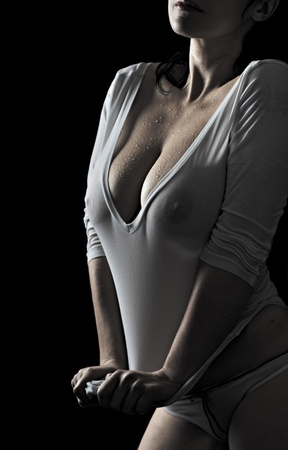 woman in wet tanktop isolated on black background