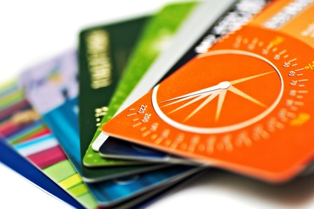 plastic money: credit cards on white background