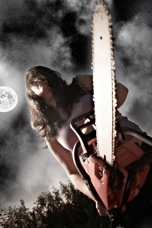 vampire with chainsaw on sky background