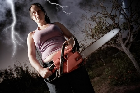 serrate: vampire with chainsaw on sky background