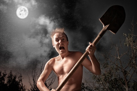anger crazy man with spade Stock Photo