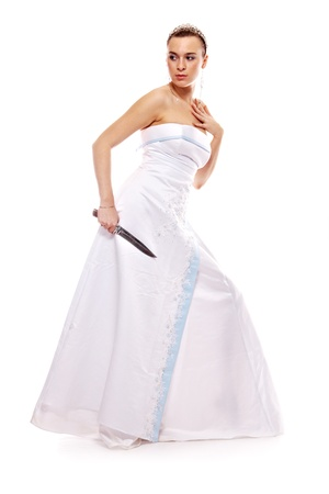 decolletage: portrait of the beautiful woman in white gown with knife on white background