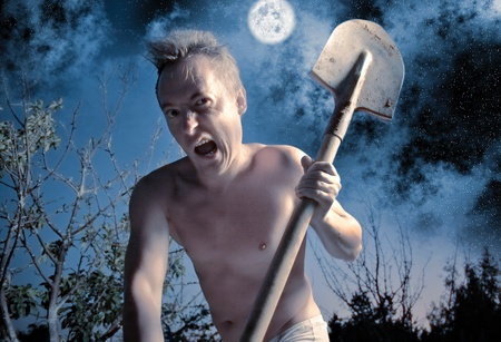 anger crazy man with spade photo