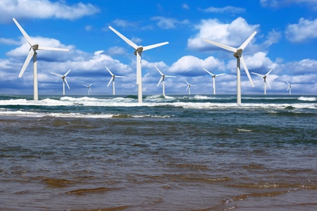 wind power: several offshore wind line on the horizon on cloudy sky background
