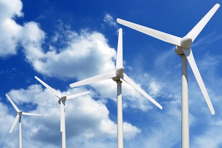 windfarm: more wind turbines online blue sky with clouds