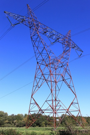 nuclear energy: on an electricity pylon against blue sky for a renewable electricity or nuclear