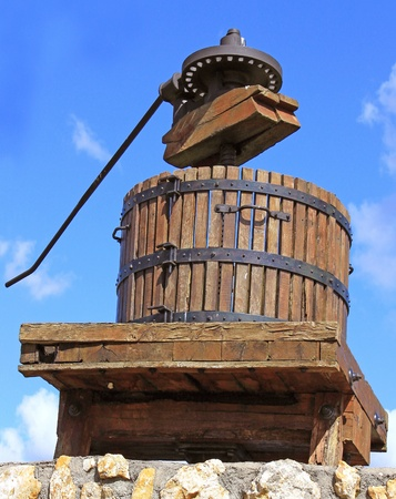 a grape press to extract the juice of grapes to produce wine