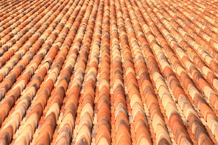 roof of a house covered with tiles photo