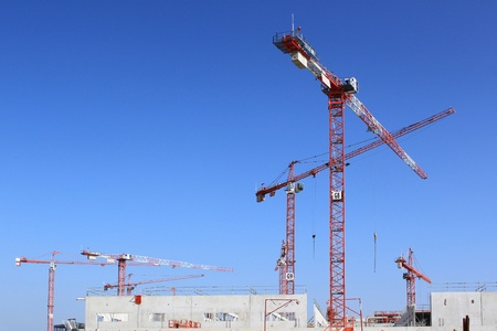 public works: for several cranes on a building construction site for building or public works Stock Photo