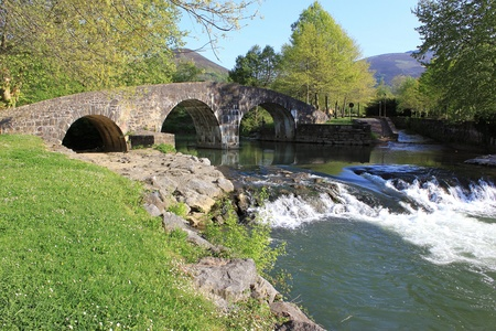 panoramic view of a waterfall river under a bridge Stock Photo