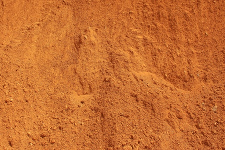 texture red earth dune of a sand pit Stock Photo
