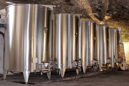 fermentation: tanks for the fermentation of wine in a cellar Editorial