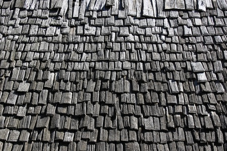 roof covered with tiles out of wooden of the Middle Ages photo