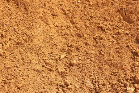 sand pit: red earth coming from a sand pit Stock Photo