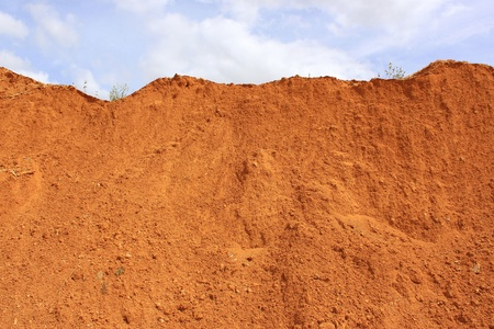 sand pit: red earth dune of a sand pit