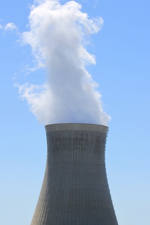 chimney of a nuclear power plant in operation photo