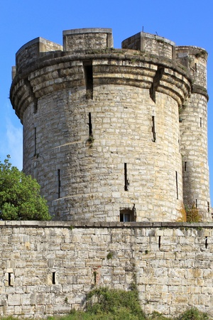 castle tower: fortifications, tower and tower of a castle on blue sky background