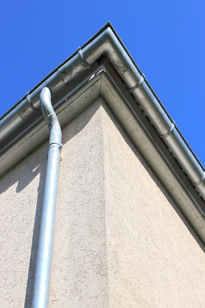 roof gutters on a house for a flow of rainwater Stock Photo