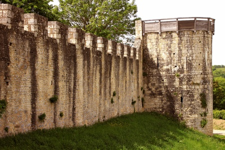 ramparts or fortifications and moat of a castle from medieval times photo