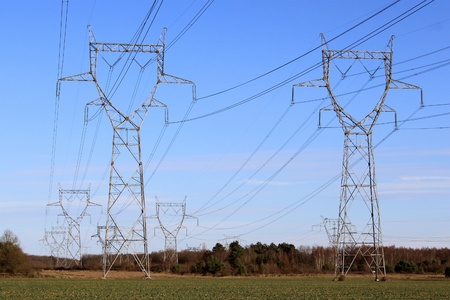 A row of electricity pylons in a field for a nuclear power Stock Photo - 17119809