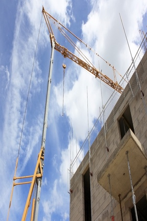 a crane at a construction site for the construction of residential housing photo