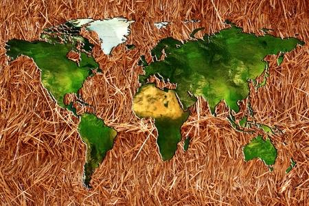 planisphere: un planisfero o un grafico del mondo su un fondo di paglia o fieno per l'agricoltura biologica