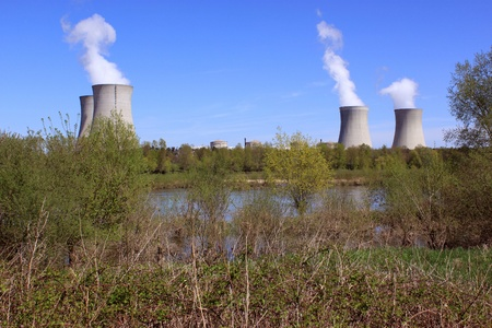 photo of an operating nuclear power plant on the banks of a river surrounded by trees Stock Photo - 19339204