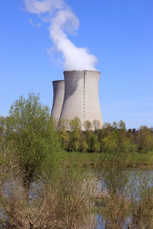 photo of an operating nuclear power plant on the banks of a river surrounded by trees Stock Photo - 19339179