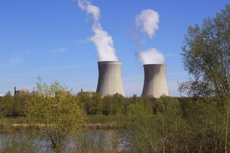 fireplaces: photo of an operating nuclear power plant on the banks of a river surrounded by trees
